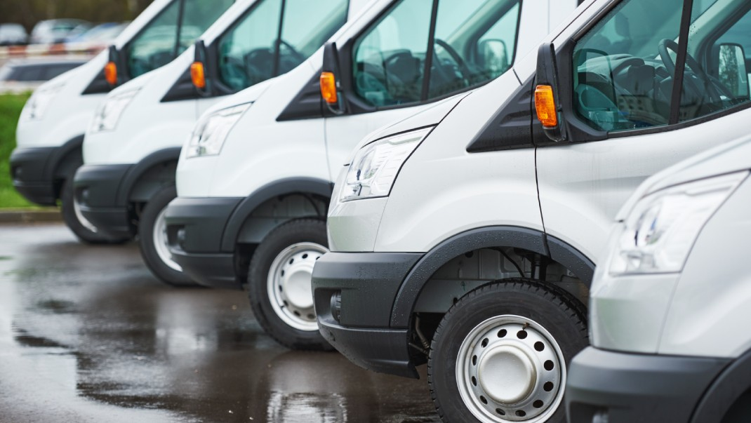 Row of vans ready to scrap for cash