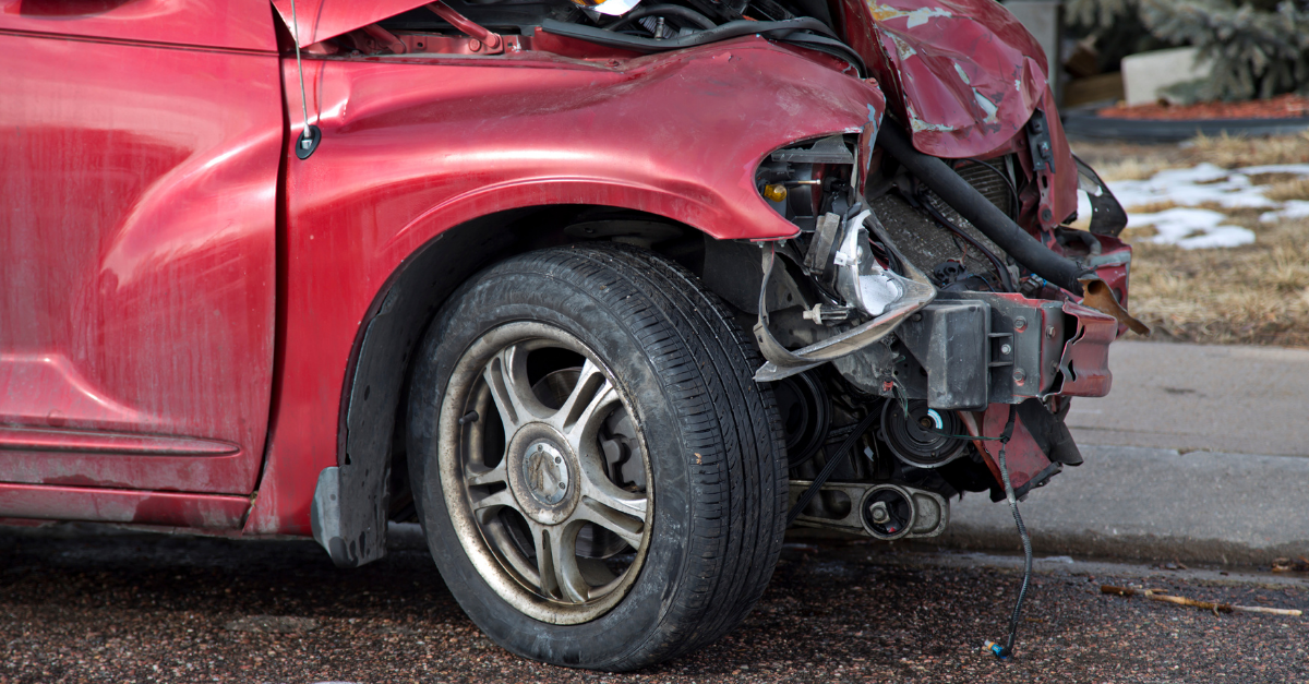 A red car with damage to front section